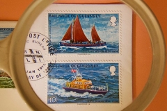 'Two lifeboat stamps through a magnifier'by Peter Shelley