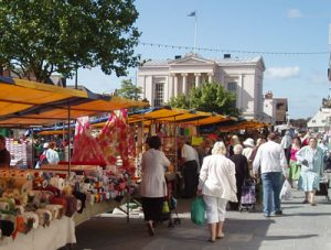Market day near the Town Hall in St Albans  (photo courtesy of St Albans City & District Council)