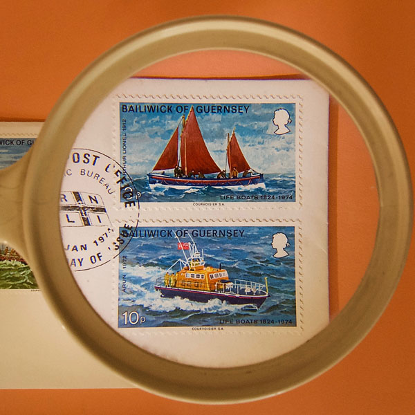 'Two lifeboat stamps through a magnifier' by Peter Shelley